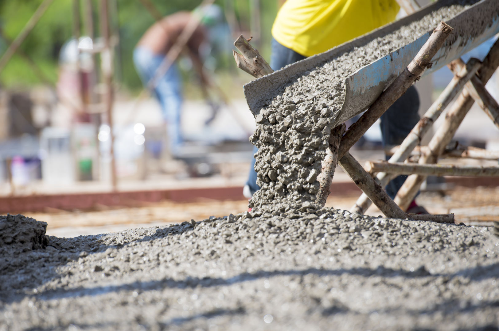 workers pouring concrete with biochar
