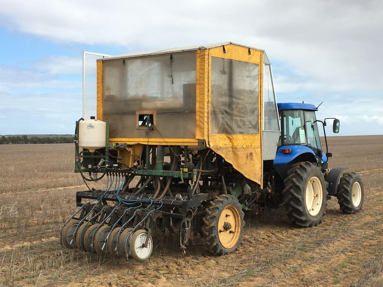 Small seeder behind tractor seeding biochar trials
